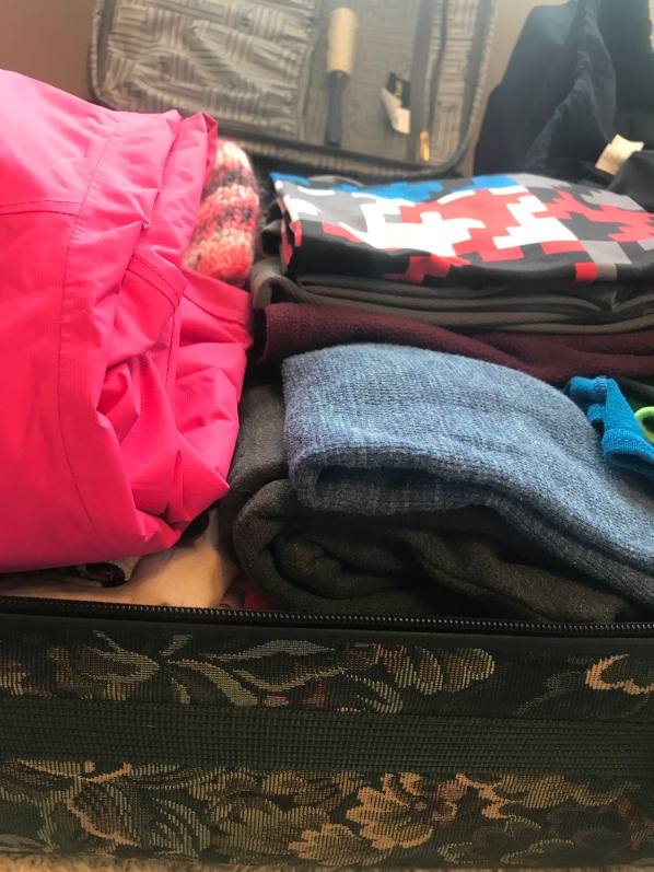 Perfectly packed suitcase, packing for kids, procrastinators suitcase