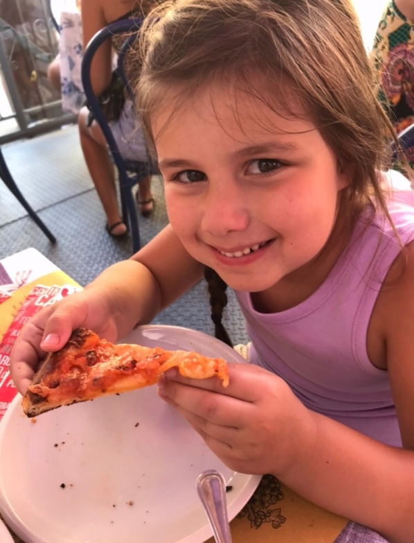 Girl eating pizza in Italy, Italian pizza dough recipe, Italian lunch, real Italy, Italian pizza, streets of small Italy, Italian Rivera